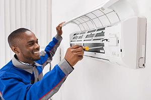hvac technician performing routine ac maintenance