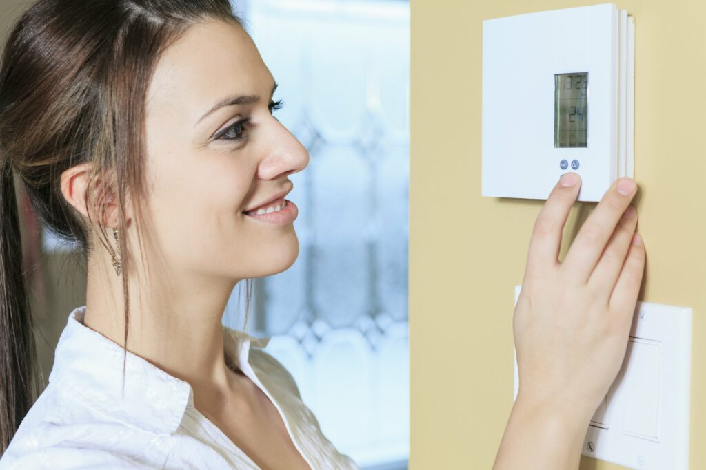 smart thermostat controlling new ac system