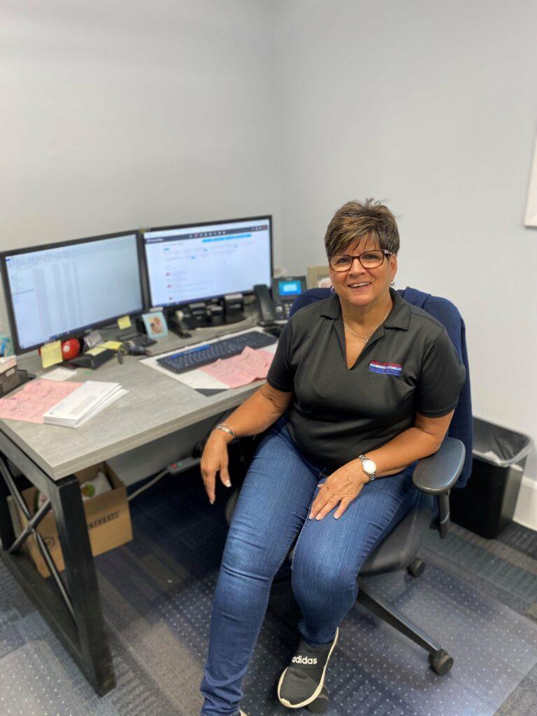 MLPH august employee spotlight roxanne working at her desk
