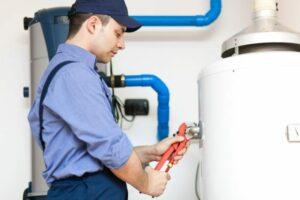 Plumber repairing a hot-water heater in Montvile, NJ